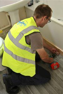 ASW Property Services worker in Carmarthenshire County Council property delivering maintenance